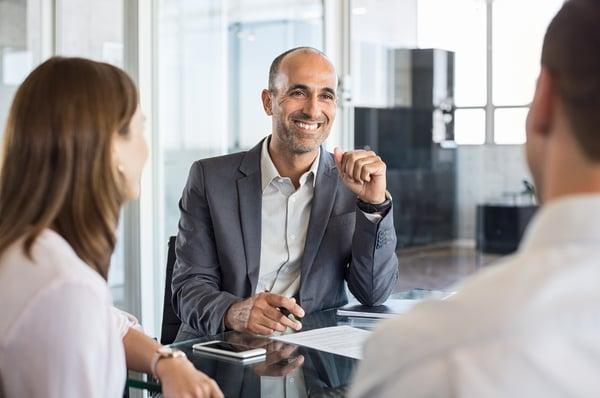 bigstock-Mature-financial-agent-in-meet-221146822