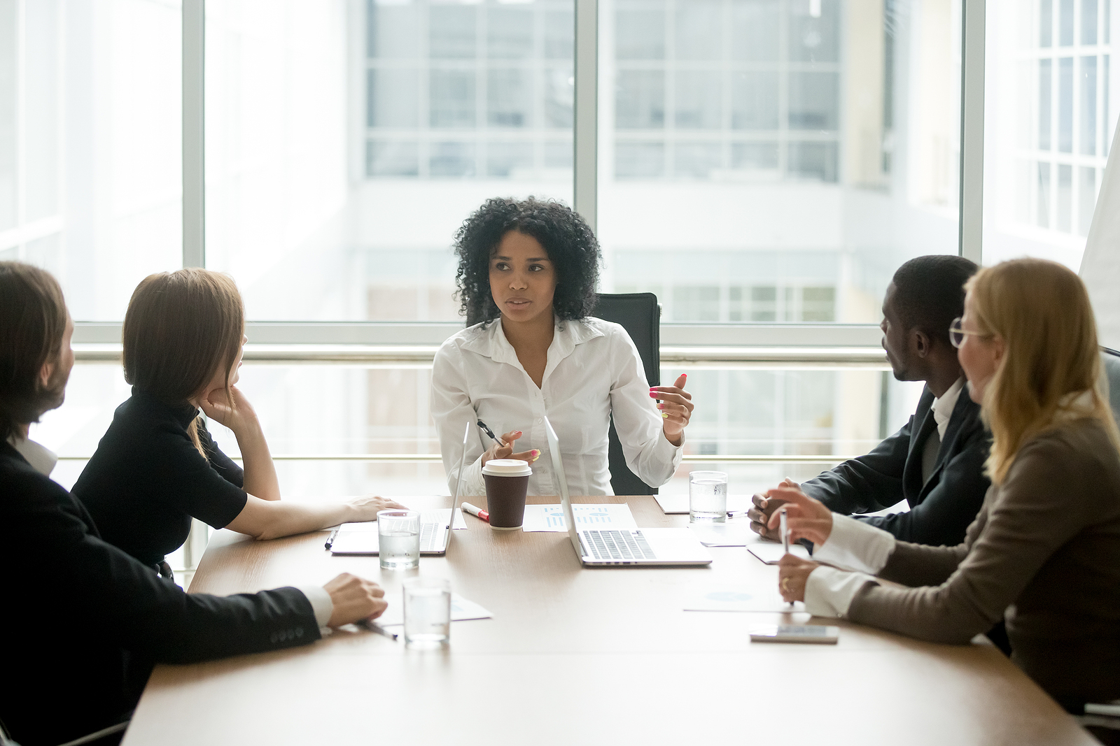 bigstock-Black-Female-Boss-Leading-Corp-229496896