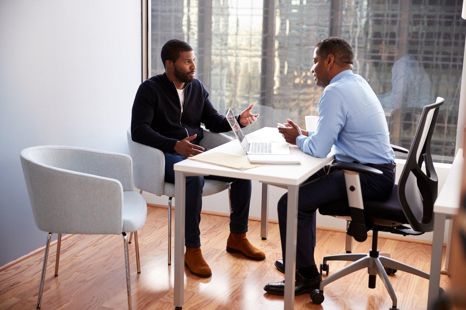 bigstock-Man-Meeting-With-Male-Financia-286367530
